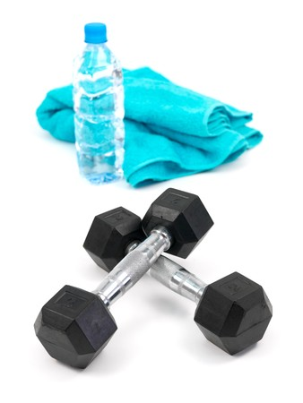 Dumbells, a bottle of water and a sports towel isolated against a white background Stock Photo - 7678227