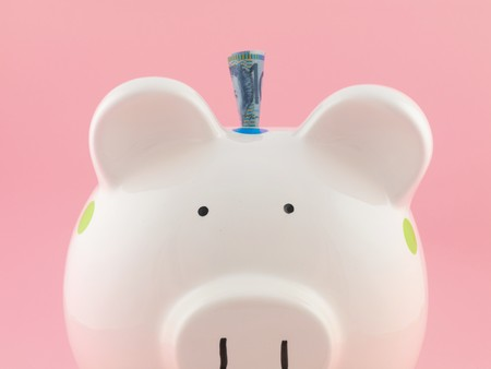 A piggy bank isolated against a pink background photo