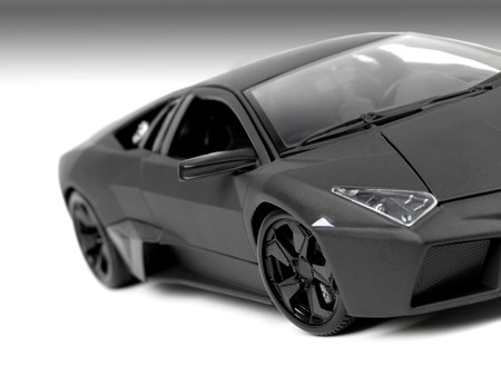 A model sports car isolated against a white background photo