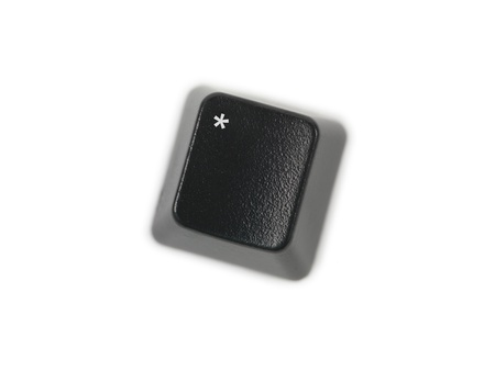 A keyboard key isolated against a white background photo