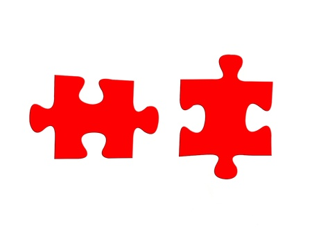 Jigsaw puzzle pieces isolated against a white background photo