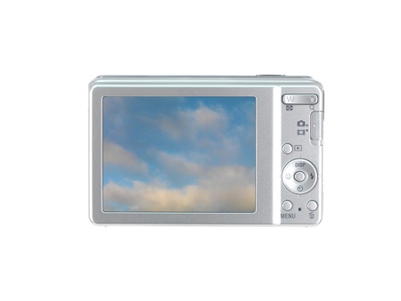 A compact camera isolated against a white background photo