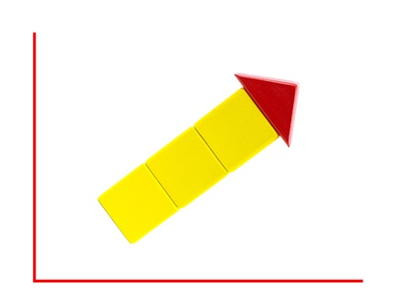 Toy blocks in the shape of an arrow on a line graph photo