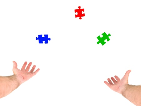 A person juggling jigsaw pieces on a white background photo