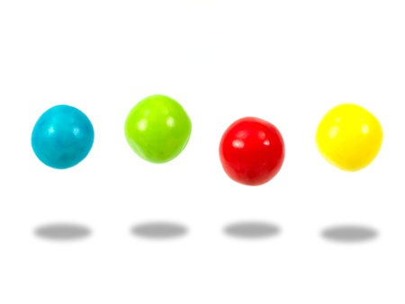 gumballs: Large colored gumballs set against a white background