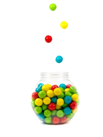lolly: Gumballs in a jar isolated against a white background