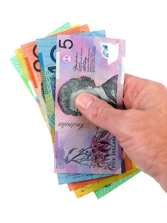 grabbing hand: Australian currency isolated against a white background