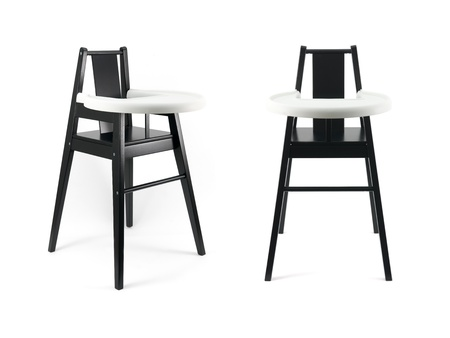 highchair: A highchair isolated against a white background Stock Photo