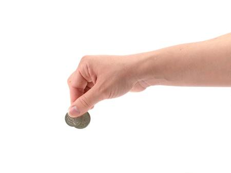 dropped: Una mano femenina con moneda aislado contra un fondo blanco