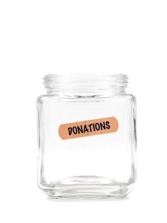 An empty money jar isolated against a white background Standard-Bild