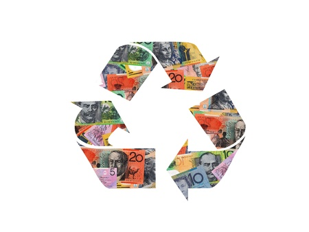 A recycle symbol from cash isolated against a white background photo