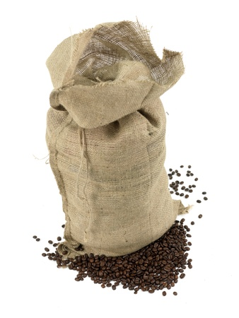 hessian bag: Coffee beans around a hessian bag isolated on white