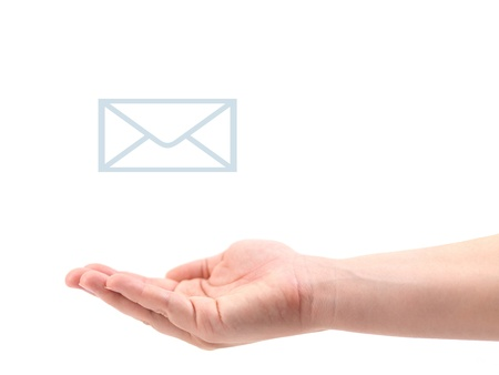 A female hand recieving mail isolated against a white background photo