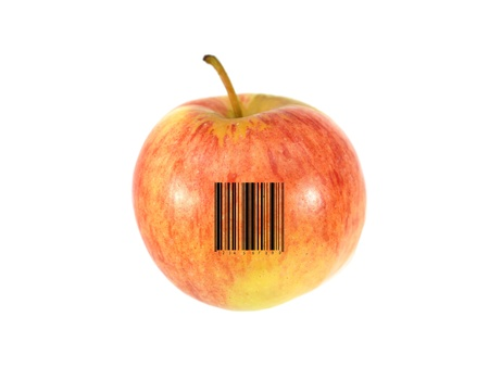 An apple with a barcode isolated against a white background photo
