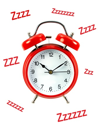 An alarm clock isolated ahgainsdt a white background photo