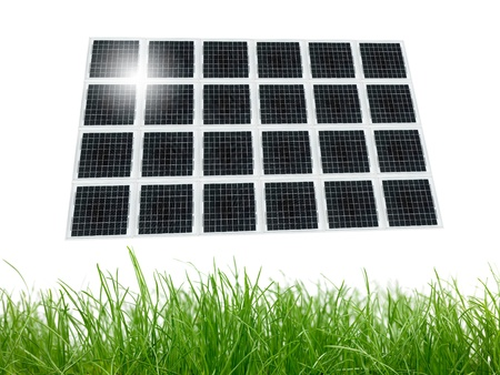 Solar panels over green grass isolated against a white background photo