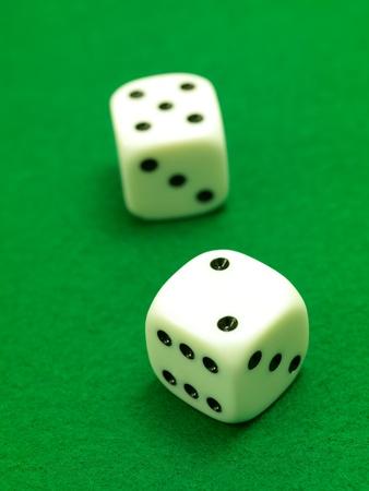 White die isolated against a green velt Stock fotó