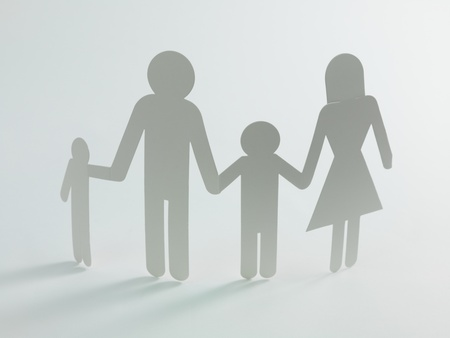 linked hands: A family cutout shape isolated against a white background