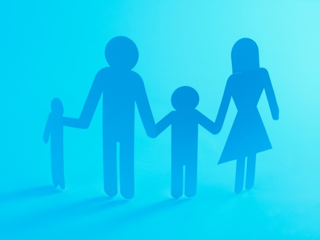 A family cutout shape isolated against a blue background photo