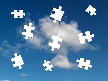 A morning shot of a cloudy blue sky with jigsaw pieces photo