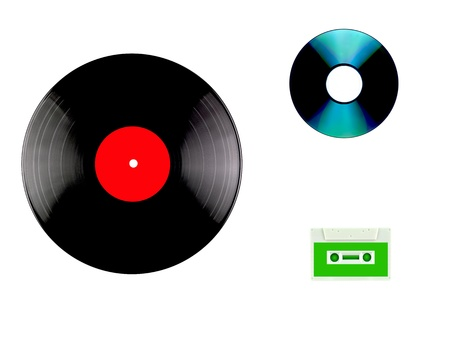 A vinyl records, compact disc and cassette isolated against a white background photo