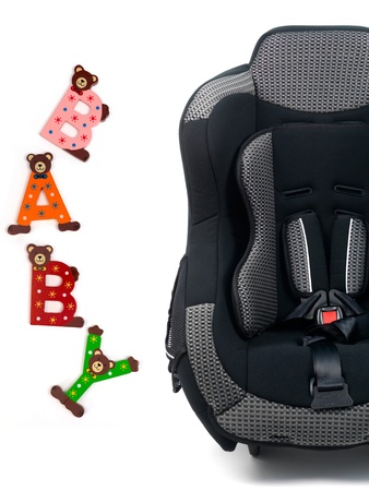 Baby car seat isolated against a white background photo
