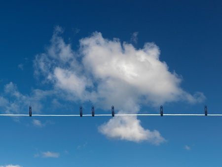 Clothes on a clothes line isolated against a blue sky Stock Photo