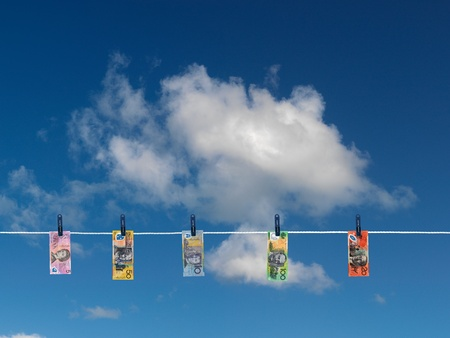 Cash on a clothes line isolated against a blue sky photo