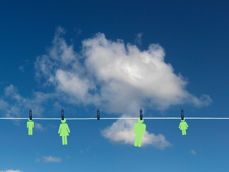 A family on a clothes line isolated against a blue sky