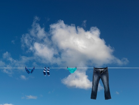 Clothes on a clothes line isolated against a blue sky photo