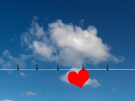 Love on the line isolated against a blue sky photo