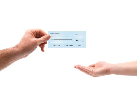 A blank bank check being exchanged on white Stock Photo