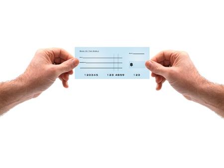 chequera: Masculinos manos sosteniendo un cheque bancario en blanco Foto de archivo