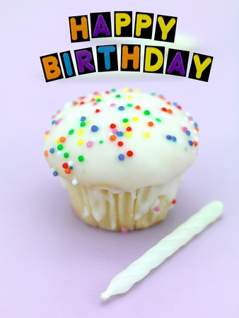 Freshly baked cup cakes with happy birthday sign photo