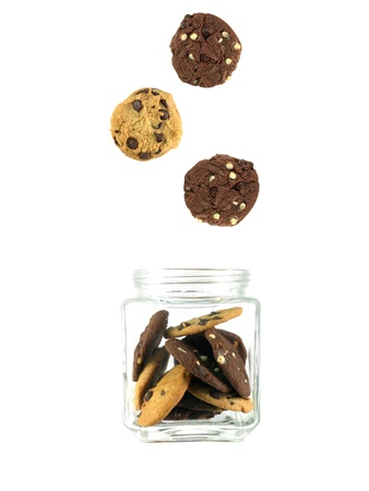 Choc chip cookies in a jar isolated against a white background photo