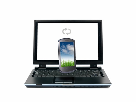 syncing: A laptop computer and a mobile phone syncing isolated against a white background Stock Photo