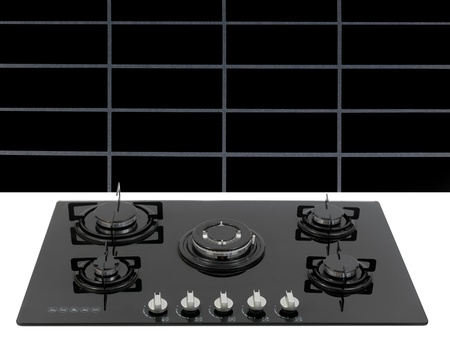 A  kitchen cooktop on a kitchen bench photo