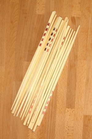 kitchen bench: Chop sticks on a wooden kitchen bench