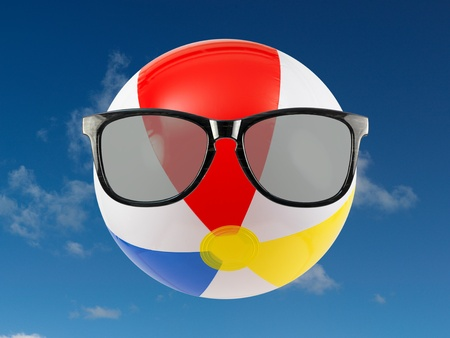 A beach ball and sunglasses isolated against a white background Stock Photo - 9865926