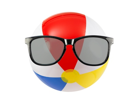 A beach ball and sunglasses isolated against a white background Stock Photo - 9865364