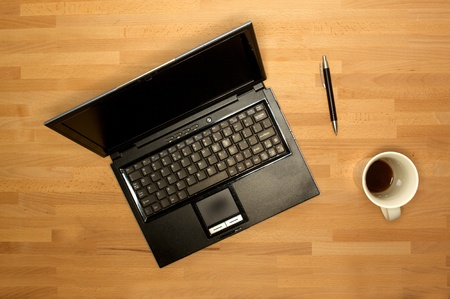 An office desk with office items in a work place scene  Stock Photo - 9865818