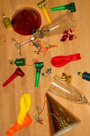 Assorted party items on a wooden floor Stock Photo