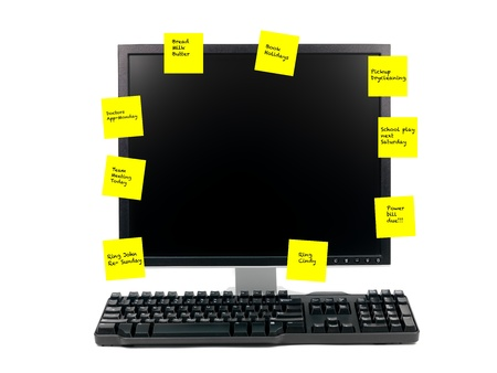 post it note: A desktop computer isolated against a white background