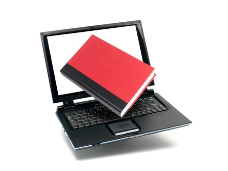 Red books and a laptop isolated against a white background photo
