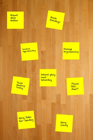wooden post: Post it notes stuck to a wooden wall