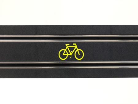 An image of a toy slot car racing track with a bicycle symbol photo
