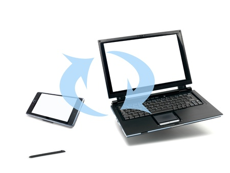 A laptop computer and a pda device  isolated against a white background Stock Photo - 10012113