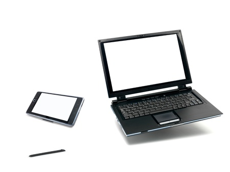 A laptop computer and a pda device  isolated against a white background photo