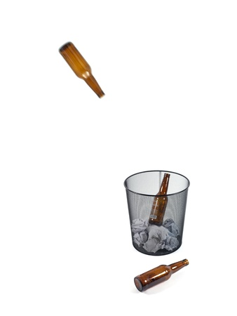 Bottles of beer in a trash can isolated against a white background Stock Photo - 10012076