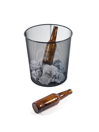 Bottles of beer in a trash can isolated against a white background Stock Photo - 10011695